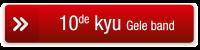 button 10de kyu geel rood